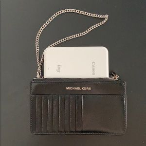 Micheal Kors blk leather wristlet w/cards inserts
